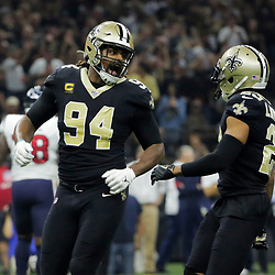 Sep 9, 2019; New Orleans, LA, USA; New Orleans Saints defensive end Cameron Jordan (94) celebrates with cornerback Marshon Lattimore (23) after a sack during the first quarter against the Houston Texans at the Mercedes-Benz Superdome. Mandatory Credit: Derick E. Hingle-USA TODAY Sports