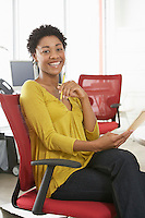 Young woman smiling in office portrait