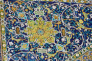 Uzbekistan, Samarqand.<br /> Registan ensemble.<br /> Mosaic at the entrance of the mosque at Tilla-Kari Medressa.