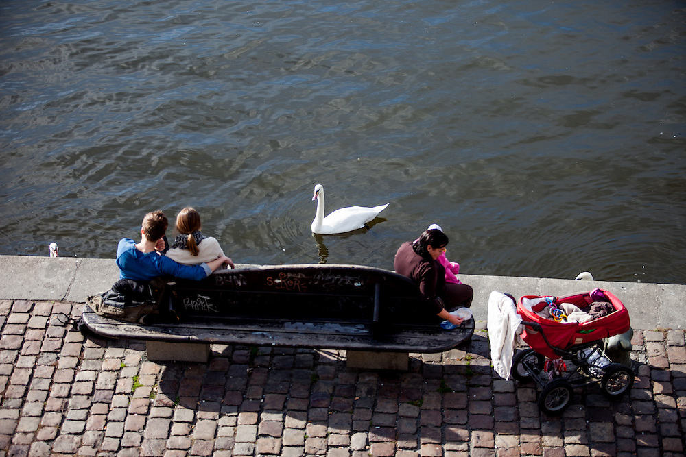 "People are resting on the ""Moldau"" riverside in Prague."