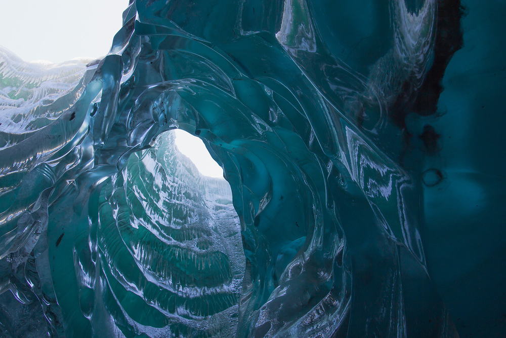 A column of blue ice that is textured flows through the Mendenhall Glacier near Juneau.