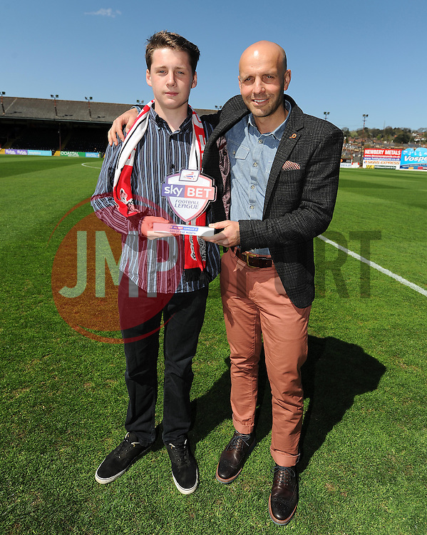 Sky Bet Football League Fan of the month, Joe McCrea, an Exeter City fan, poses with the trophy and Exeter City Manager Paul Tisdale. - Photo mandatory by-line: Harry Trump/JMP - Mobile: 07966 386802 - 18/04/15 - SPORT - FOOTBALL - Sky Bet League Two - Exeter City v Southend United - St James Park, Exeter, England.