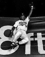 MINNEAPOLIS, MN-UNDATED: MLB Hall of Fame outfielder Kirby Puckett poses for a portrait while jumping into the outfield wall (The Baggie) at the Metrodome in Minneapolis, Minnesota.  (Photo by Ron Vesely)