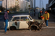 Months after the fall of the Berlin wall and the collapse of the communist GDR state (the German Democratic Republic), the wreckage of a Trabant car still remains, on 15th June 1990, in Berlin, Eastern Germany. (Photo by Richard Baker / In Pictures via Getty Images)