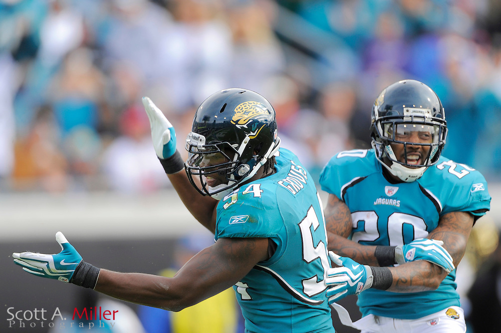 Dec. 6, 2009; Jacksonville, FL, USA; Jacksonville Jaguars defensive end Quentin Groves (54) and safety Anthony Smith (20) celebrate a sack during the Jags game against the Houston Texans at Jacksonville Municipal Stadium. ©2009 Scott A. Miller