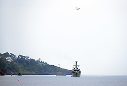 © Licensed to London News Pictures.  02/06/2017; Torbay, Devon, UK. Torbay Airshow 2017. Press call for Launch of the 2017 Torbay Airshow. An RAF Typhoon performs a display over Royal Navy Frigate HMS Somerset in Tor Bay ahead of the 2017 Torbay Airshow.The 2017 Torbay Airshow is set to return this weekend on Saturday 3 and Sunday 4 June with an action packed programme of world class air displays. The world's premier aerobatic team The Red Arrows will be debuting a new routine in the first display of their season, featuring their trademark combination of close formations and precision flying. The full display programme for the weekend begins on the Saturday between 2-3pm with The Tigers Freefall Parachute Display Team, Team Raven Aerobatic Display Team, the Percival Piston Provost and the Strikemaster. From 3-4pm will be the highly anticipated display by the Red Arrows, former British Female Aerobatic Champion Lauren Richardson in her Pitts Special S1-S and world aerobatic competitor Gerald Cooper in his Xtreme XA41. Finishing off the action packed afternoon from 4-5pm will see displays from the AutoGyro, the Battle of Britain Memorial Flight aircraft, the PBY5A Catalina seaplane, The Blades and the Royal Air Force's Typhoon FGR4. Sunday afternoon will see each of the aircraft take to the skies again before the weekend closes with a final display from the RAF Chinook team. The two day show, which had its inaugural event last year, takes place on Paignton Green with the Bay providing a stunning natural amphitheatre for viewing the air displays and the perfect location for a large coastal airshow event. To stay up to date with the latest Torbay Airshow news and updates follow @torbayairshow on Facebook, Twitter and Instagram or visit www.torbayairshow.com. Picture credit : Simon Chapman/LNP