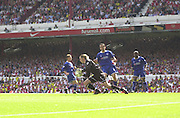 Premiership Football - Arsenal v Leicester City:.2003/04 Season - 15/05/2004  [Record breaking Season undefeated] .Ian Walker, comes out foe a low ball[Credit] Peter Spurrier Intersport Images