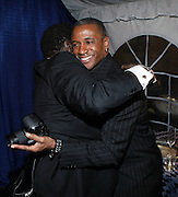 l to r: Tommy Davidson and Eddie Levert at the The Radio One Inaugural Celebration 2009 Hennessey VIP Lounge Salute held at Lincoln Theater in Washington, DC on January 17, 2009..CATHY HUGHES, RADIO ONE FOUNDER AND CHAIRPERSON had a Hometown Inaugural Salute to President Barack Obama and Tom Joyner at the Lincoln Theater in Washington DC. Hennessy hosted celebrities and guests in a branded Hennessy lounge where Tatiana Ali interviewed celebrities about their feelings toward the Barack Obama Presidency. Celebrities in attendance included Jamie Foxx, Alonzo Morning, Eddie Levert, T. D. Jakes, Rev. Al Sharpton, Jackie Reid, Roland Martin, Dick Gregory, Raheem DaVaughn, Bow Bow, and more. Hennessy presented a commemorative Hennessy 44 Bottle which was signed by numerous celebrities which will be auctioned to create 4 four-year scholarships via the Thrugood Marshall College Fund...