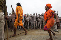 A group of Naga Sadhu (naked holy men) have just bathed in the Ganga and are in a procession through a crowd of millions. They are being protected by the men in orange. These Sadhu are solely dedicated to achieving liberation, the fourth and final stage of life, through meditation and contemplation.