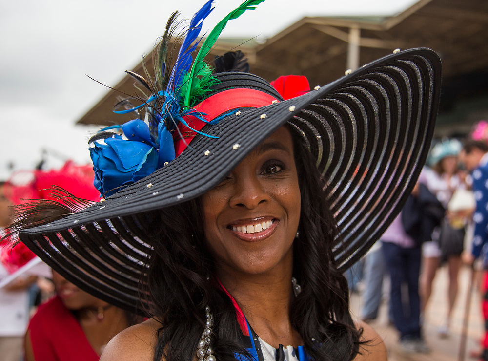 A woman wearing a hat poses for a portrait at Santa Anita Park the day of the Kentucky Derby celebrated Saturday May 6, 2017. <br /> <br /> photo by Samuel Navarro / Sport Shooter Academy.