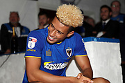 AFC Wimbledon striker Lyle Taylor (33) smiling during the EFL Sky Bet League 1 match between AFC Wimbledon and Rotherham United at the Cherry Red Records Stadium, Kingston, England on 17 October 2017. Photo by Matthew Redman.