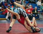 Benjamin Quattroci of Fairport competes against Will Raes of Midlakes in the 126-pound weight class during a match at Fairport High School on Saturday, December 13, 2014.