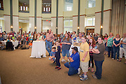 A crowd gathers at Walter Hall for Ohio University's Earth Day celebration April 22, 2014.  The event was sponsored by the Office of Sustainability, ReUse Industries and the Voinovich School of Leadership.