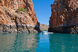 Passengers on a charter boat travel through the Horizontal Waterfalls.