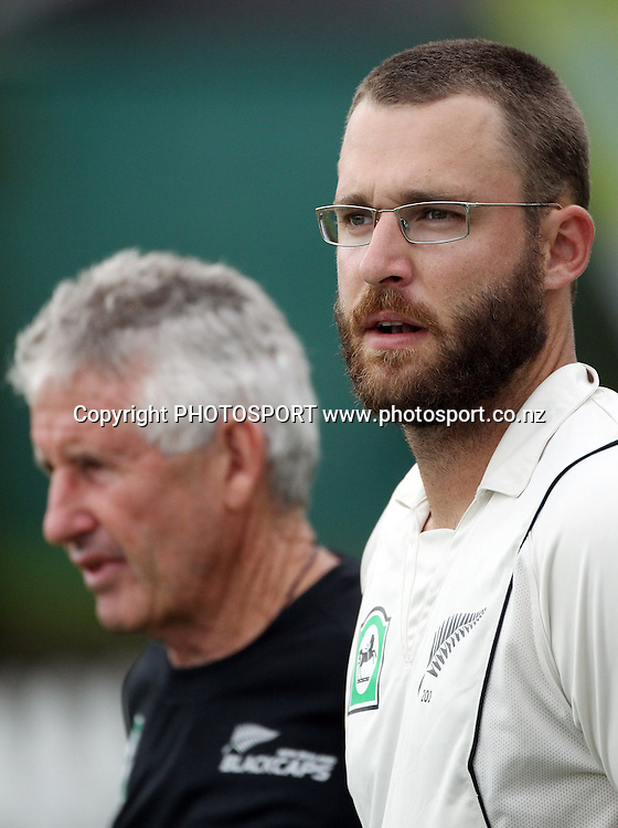 New Zealand captain Daniel Vettori looks out at the weather as Manager Dave Currie looks on in the background.<br />Day 1. Test match cricket. One off test.<br />New Zealand Black Caps versus Bangladesh.<br />Seddon Park, Hamilton, New Zealand.<br />Monday 15 February 2010.<br />Photo: Andrew Cornaga/PHOTOSPORT