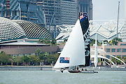 Emirates Team New Zealand leads in race one of the Extreme Sailing Series regatta being sailed in Singapore. 20/2/2014