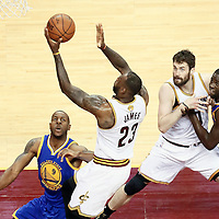 10 June 2016: Cleveland Cavaliers forward LeBron James (23) goes for the layup over Golden State Warriors forward Andre Iguodala (9) as Golden State Warriors forward Draymond Green (23) vies with Cleveland Cavaliers forward Kevin Love (0) during the Golden State Warriors 108-97 victory over the Cleveland Cavaliers, during Game Four of the 2016 NBA Finals at the Quicken Loans Arena, Cleveland, Ohio, USA.