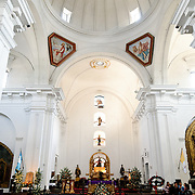 Interior and altar of the Iglesia de San Francisco in Antigua, Guatemala.