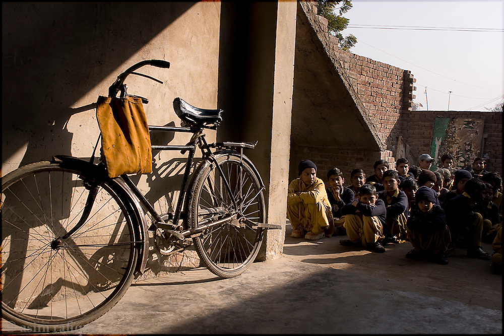 children wait for the start of classes at a school in a village of landless peasants - such schools are mostly paid for by the village residence as there is a serious shortage of government school in such remote and poor villages
