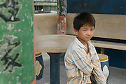 Portrait of a boy sitting in the courtyard of an ancient temple in Wenzhou, Zhejiang, China.