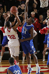 Eastern's Lionell Gaines, right, blocks a shot by Scott County's Tamron Manning in the second half. Scott County hosted Eastern at home Tuesday, Feb. 15, 2011. Eastern won 66-60. Gaines scored 22 points and Manning contributed scored 8.