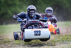 © Licensed to London News Pictures. 04/05/2019. Billingshurst, UK. Competitors take part in a race at the British Lawn Mower Championships near Billingshurst in West Sussex. A weekend long set of races using specially adapted lawn mowers will see a winner announced on Sunday. Photo credit: Peter Macdiarmid/LNP