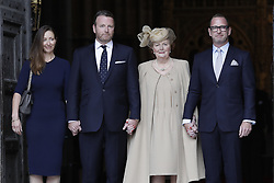 © Licensed to London News Pictures. 27/09/2016.  The family of Sir Terry Wogan , including his widow Lady Helen Wogan, daughter Katherine (L) and sons Alan and Mark stand at the West Door of Westminster Abbey after attending a Service of Thanksgiving for the Life and Work of Sir Terry Wogan . Veteran broadcaster Sir Terry Wogan died in January 2016. The Irish star had a long and successful career at the BBC, including stints on  radio and TV. London, UK. Photo credit: Peter Macdiarmid/LNP