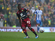 Norwich City Alexander Tettey on the ball during the Sky Bet Championship match between Brighton and Hove Albion and Norwich City at the American Express Community Stadium, Brighton and Hove, England on 3 April 2015. Photo by Phil Duncan.