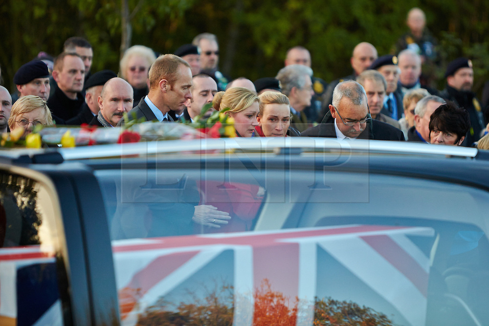 © Licensed to London News Pictures.  14/11/2013. CARTERTON, UK. Friends and family pay their respects the repatriation ceremony for Warrant Officer Class 2 Ian Michael Fisher from the 3rd Battalion, the Mercian Regiment. He is the 446th UK service member to die in Afghanistan since operations began. Photo credit: Cliff Hide/LNP