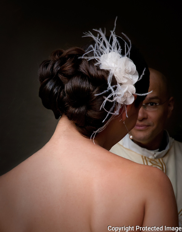 Bride and Priest talking