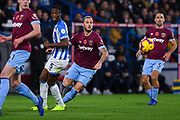 Marko Arnautovic of West Ham United (7) nips past Terence Kongolo of Huddersfield Town (5) during the Premier League match between Huddersfield Town and West Ham United at the John Smiths Stadium, Huddersfield, England on 10 November 2018.