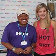 August 16, 2014, New Haven, CT:<br /> Eugenie Bouchard poses for a photograph with Floyd Green in the Aetna booth during WTA All-Access Hour on day three of the 2014 Connecticut Open at the Yale University Tennis Center in New Haven, Connecticut Sunday, August 17, 2014.<br /> (Photo by Billie Weiss/Connecticut Open)