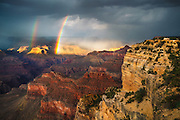 A double rainbow forms on Brahma and Zoroaster Temples, in the Grand Canyon, after a summer thunderstorm.