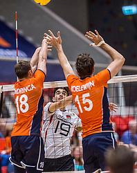 05-06-2016 NED: Nederland - Duitsland, Doetinchem<br /> Nederland speelt de laatste oefenwedstrijd ook in  Doetinchem en speelt gelijk 2-2 in een redelijk duel van beide kanten / Daniel Malescha #19, Robbert Andringa #18, Thomas Koelewijn #15