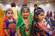 10 AUGUST 2012 - PHOENIX, AZ:  Girls dressed as Rhada wait for a pageant to start during the celebration of Janmashtami at Ekta Mandir, a Hindu temple in central Phoenix. In the Hindu religion, Rhada is the friend of lover of Krishna. Janmashtami is the Hindu holy day that celebrates the birth of Lord Krishna. Hindu communities around the world celebrate the holy day. In Arizona, most of the Hindu temples in the Phoenix area have special celebrations of the day. PHOTO BY JACK KURTZ