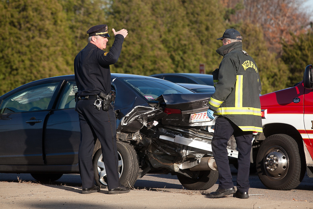 Needham, MA 03/27/2012.Needham Police officers look at a Honda Civic that was hit by a Needham Police cruiser on Tuesday afternoon on Highland Ave. over 128..Wicked Local Photo by Alex Jones
