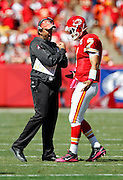 Kansas City Chiefs head coach Todd Haley talks to Kansas City Chiefs quarterback Matt Cassel (7) during the NFL week 4 football game against the Minnesota Vikings on Sunday, October 2, 2011 in Kansas City, Missouri. The Chiefs won the game 22-17. ©Paul Anthony Spinelli