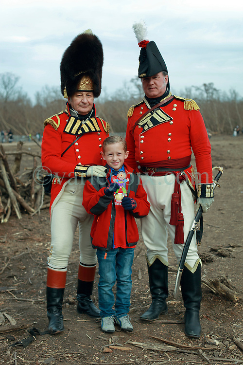 11 January 2015. New Orleans, Louisiana. <br /> Bicentennial reenactment of the Battle of New Orleans in Chalmette. <br /> L/R; Capt Larry Stutt of the 8th Regiment afoot, Major Hal Dennison of the 1st Regiment afoot Royal Scots Guards and Ben after re-enacting the January 8th, 1815 marking the 200th anniversary of the Battle of New Orleans in Chalmette. Despite heavily outnumbering the Americans, the British suffered over 2,000 casualties, with many senior officers amongst the dead and injured compared to the Americans who suffered a mere 70 by comparison. The American victory was hailed as miracle.<br /> Photo; Charlie Varley/varleypix.com