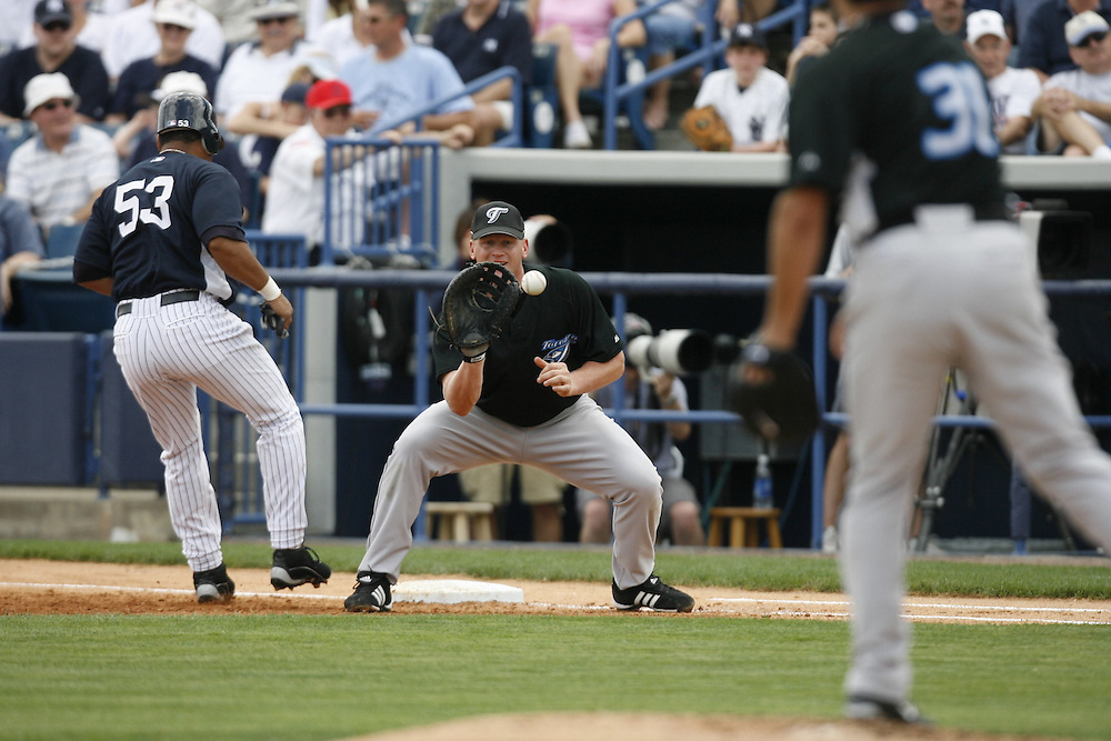 during the inning of their MLB spring training baseball game in Tampa, Florida March 24, 2007. REUTERS/Scott Audette (UNITED STATES)