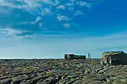 Two men on coastal rocks in Doolin, County Clare, West Coast of Ireland