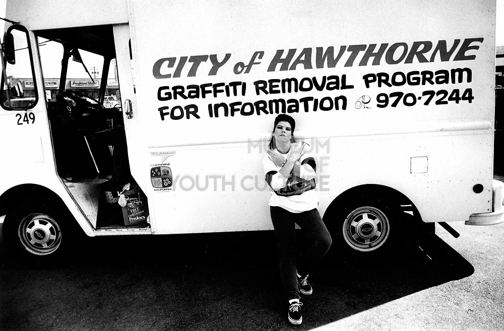 A female gang member posing by the Graffiti removal van, Hawthorne, LA, USA, 1990's