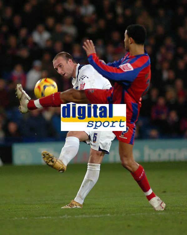 Photo: Kevin Poolman.<br />Crystal Palace v Colchester United. Coca Cola Championship. 09/12/2006. Kevin Watson of Colchester clears the ball from palace player Jobi McAnuff.