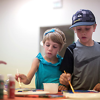 Rozlyn Good and her brother Griffin Good work on paintings during the Kids College art camp at the University of New Mexico branch in Rio West Mall in Gallup Monday. The site will host Kids College throughout the month of June and July where students can come to work on arts and crafts. To join the program, call 505-863-7738 and preregister your child.