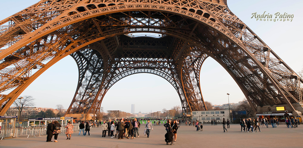 Visitors at the base of the Eiffel Tower, Paris