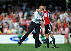 Charlton Athletic Manager, Bob Peeters hugs Brentford's Tony Craig after the match - Photo mandatory by-line: Patrick Khachfe/JMP - Mobile: 07966 386802 09/08/2014 - SPORT - FOOTBALL - Brentford - Griffin Park - Brentford v Charlton Athletic - Sky Bet Championship - First game of the season