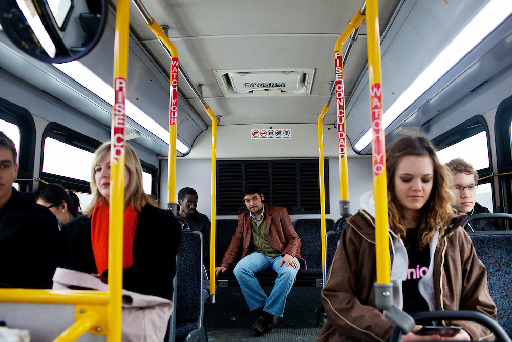 People ride a COTA bus in Columbus, Ohio on Friday, February 25, 2011. Senate Bill 5 would eliminate collective bargaining rights for state workers, which Governor John Kasich claims is a necessary reaction to the budget crisis.