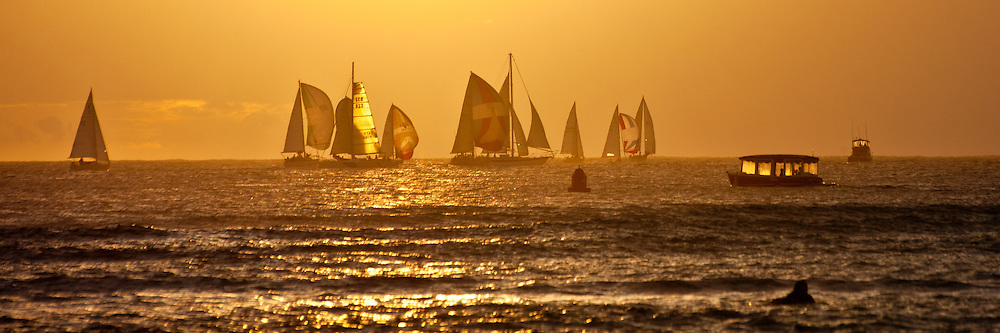 Sailing race at sunset off Waikiki Beach in Honolulu, Hawaii
