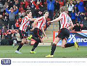 Dan Holman scores his first goal and celebrates during the Vanarama National League match between Cheltenham Town and Bromley at Whaddon Road, Cheltenham, England on 30 January 2016. Photo by Antony Thompson.