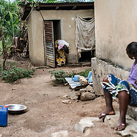 19/04/2014. Quartier de Kango II. Gueckedou. Guin&eacute;e Conakry.  <br /> <br /> Suite &agrave; un appel, une &eacute;quipe de MSF va chez Finda Marie Kamano, 33 ans, elle ressent une grande faiblesse, avec des vomissements et dysenterie. Avec la fi&egrave;vre, et les saignements de nez, ce sont les sympt&ocirc;mes provoqu&eacute;s par le virus Ebola.<br /> <br /> <br /> Finda sort des toilettes, elle est tr&egrave;s faible.<br /> <br /> Following a call, an MSF team goes to consult Finda Marie Kamano, 33 years, she feels great weakness with vomiting and dysentery. With fever, and nose bleeds, what the symptoms are caused by the Ebola virus.<br /> <br /> Finda out of the bathroom, she is very tired.<br /> <br /> <br /> &copy;Sylvain Cherkaoui/Cosmos/MSF