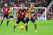 AFC Bournemouth midfielder Matt Ritchie and Arsenal defender Nacho Monreal during the Barclays Premier League match between Bournemouth and Arsenal at the Goldsands Stadium, Bournemouth, England on 7 February 2016. Photo by Graham Hunt.